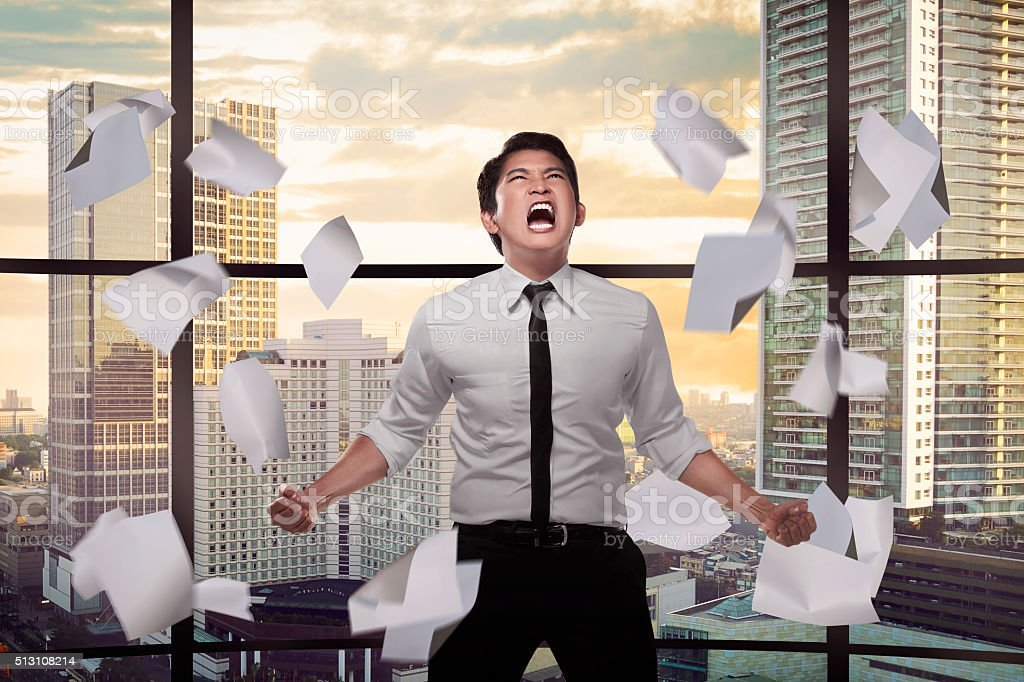 Asian business person depressed on the office stock photo