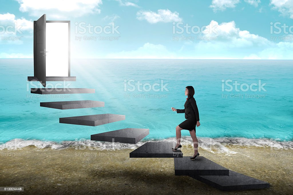 Asian business person going up to the door using stair stock photo