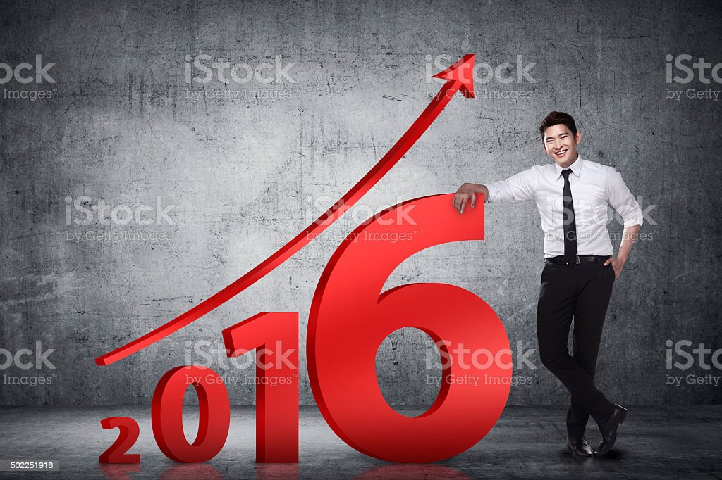 Asian business person lean next to 2016 number stock photo