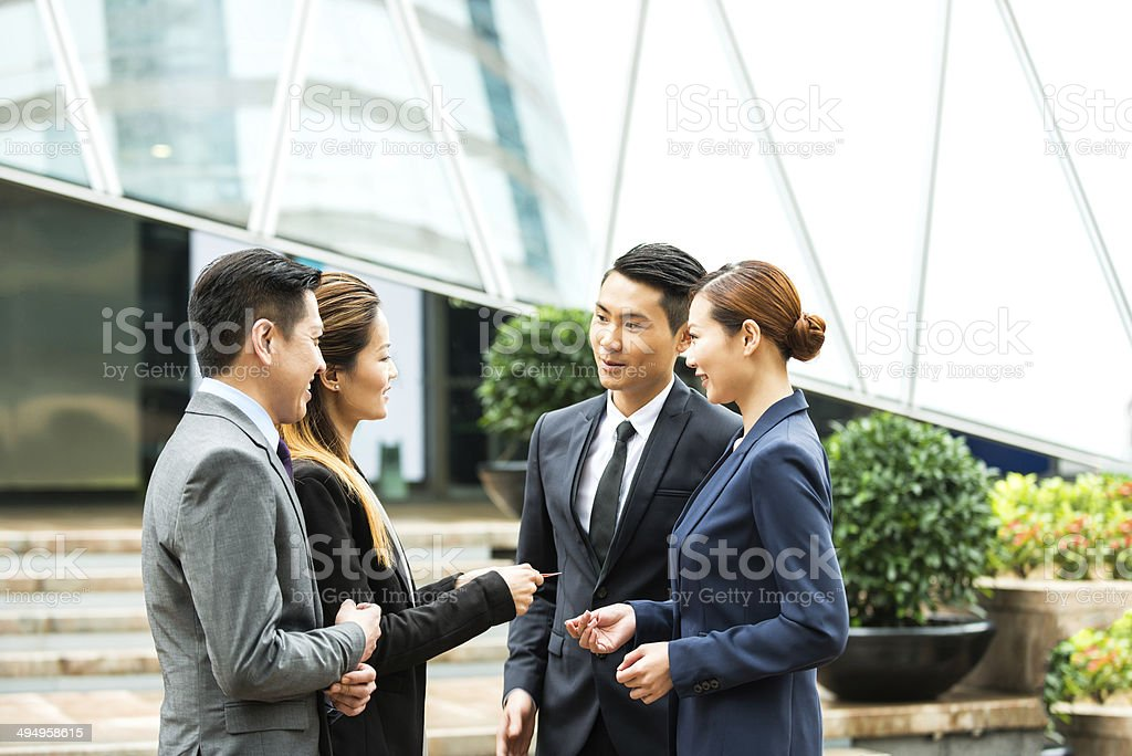 Asian Business Team Exchanging Business Card stock photo