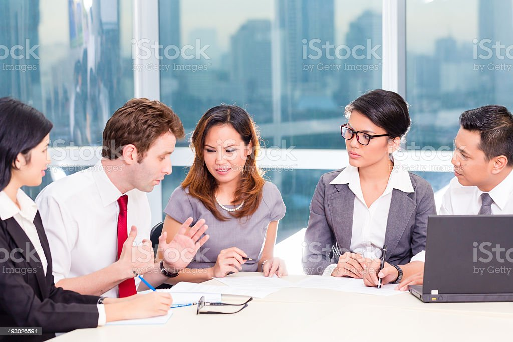 Asian Business Team in Strategy meeting stock photo