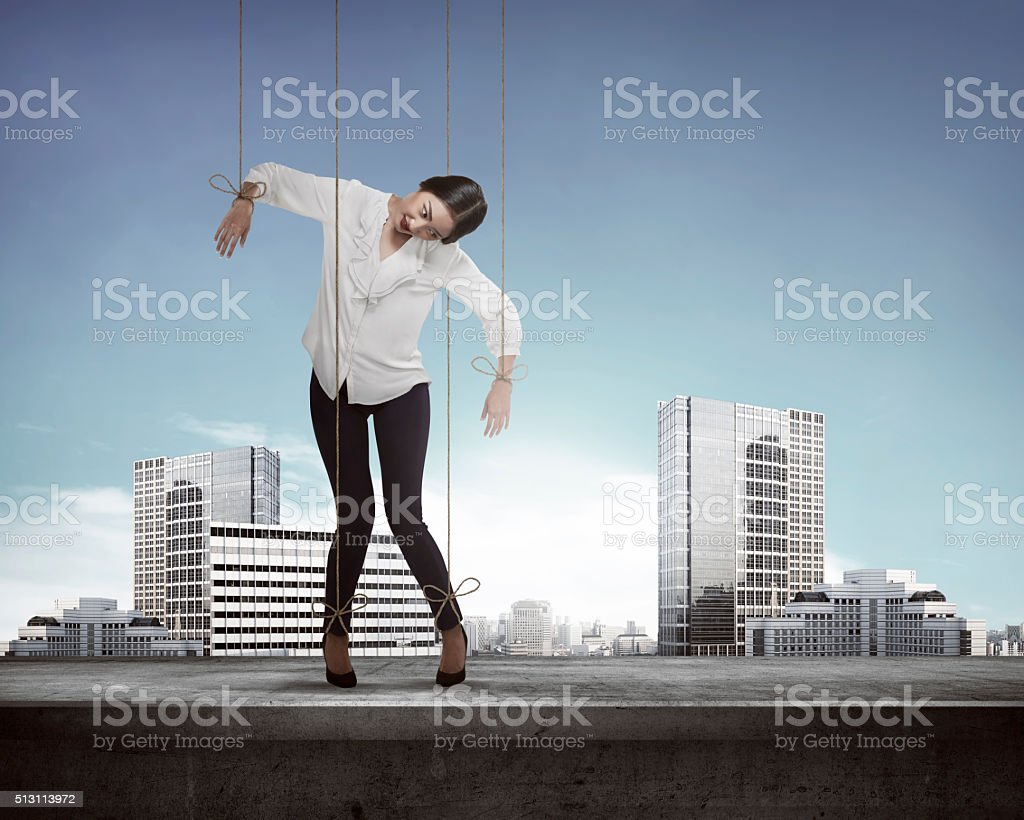 Asian business woman have string attached stock photo