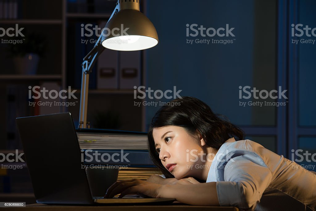 asian business woman sleepy working overtime late night stock photo