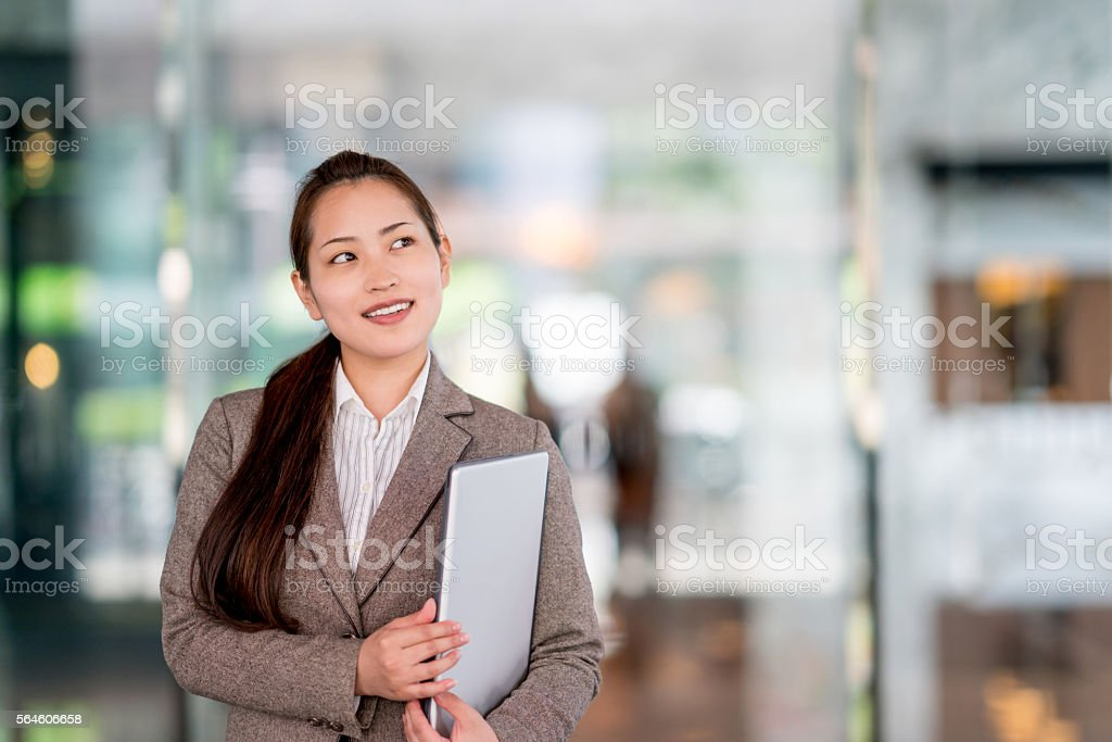Asian business woman thinking stock photo