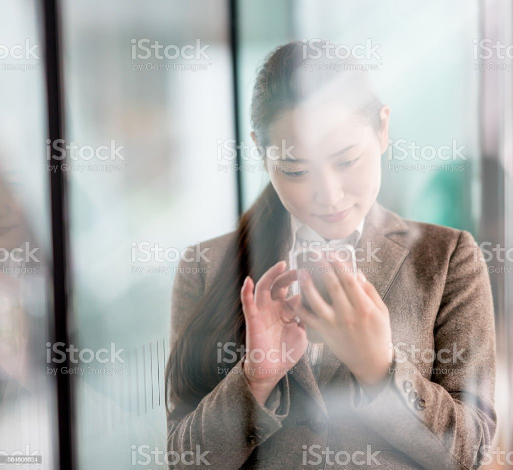 Asian business woman using mobile phone stock photo