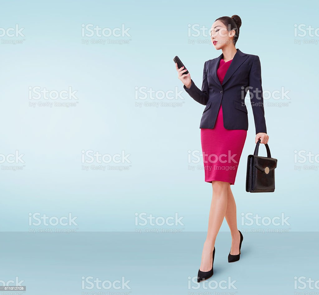 Asian business woman with bag and cellphone Isolated copyspace. stock photo