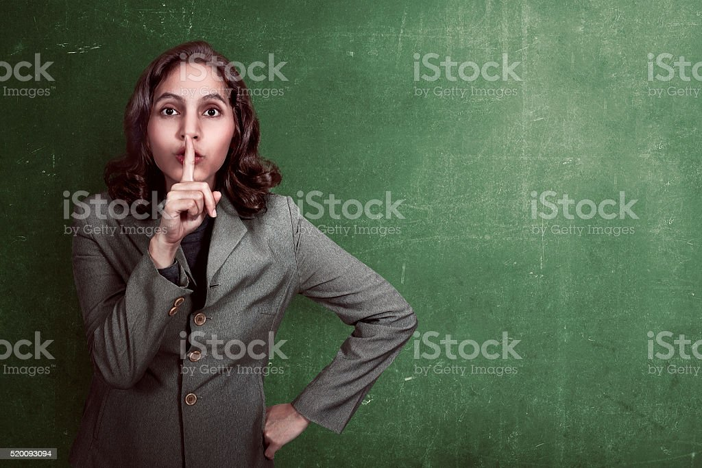 Asian business woman with silent gesture stock photo