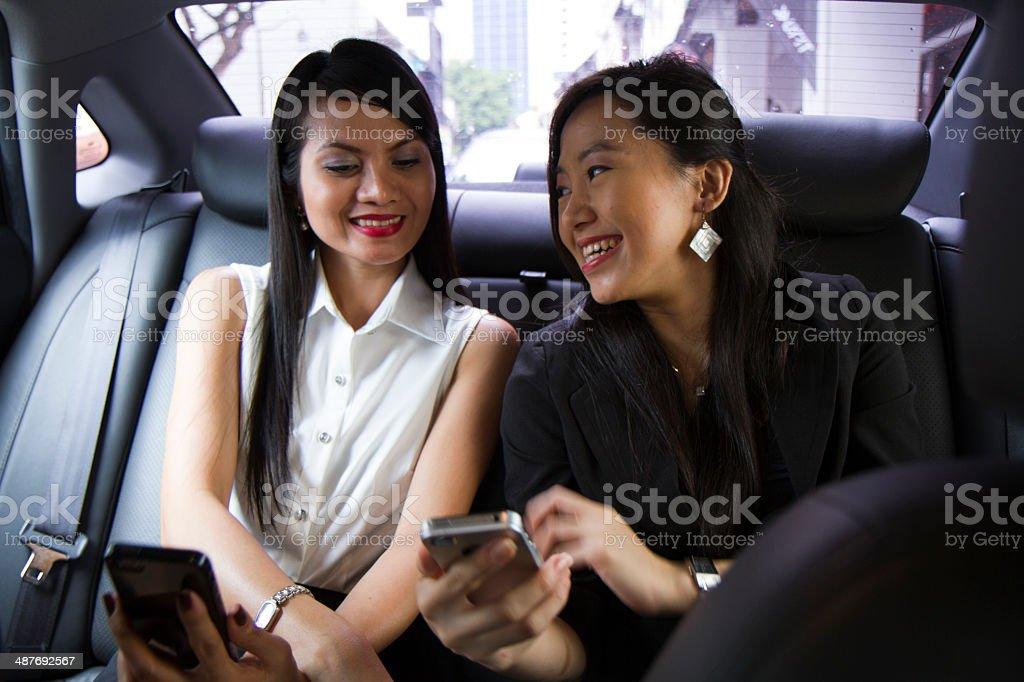 Asian business women sharing information stock photo