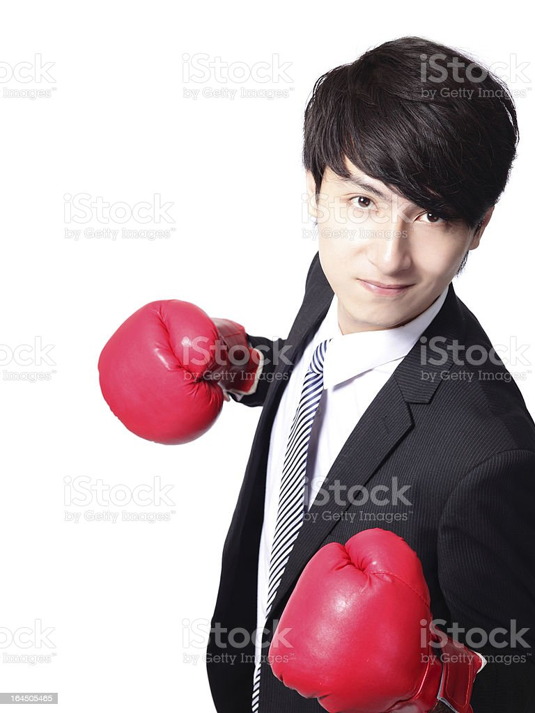 Asian businessman battle with boxing glove royalty-free stock photo