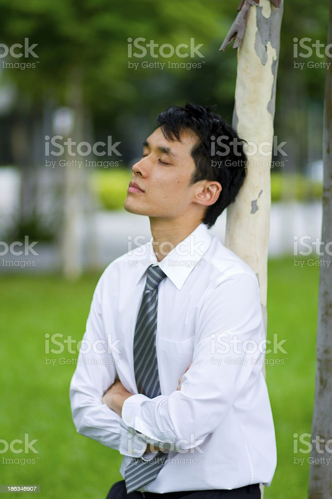 Asian Businessman Deep In Thought royalty-free stock photo
