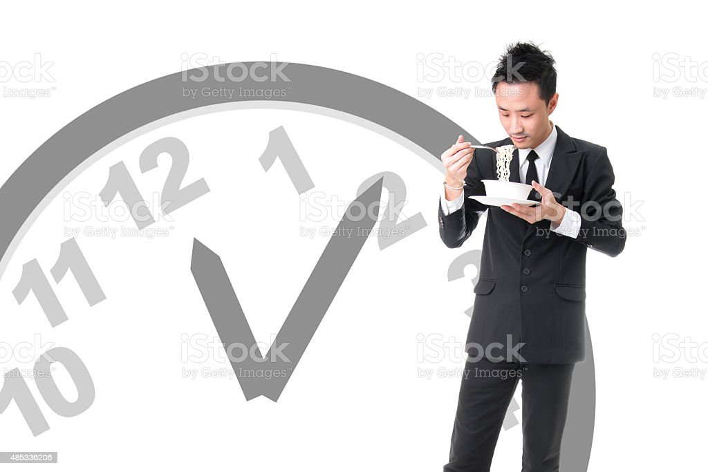 Asian Businessman Eating Chinese Noodle Soup At Noon royalty-free stock photo
