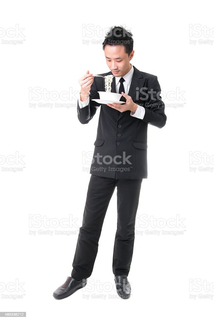 Asian Businessman Eating Chinese Noodle Soup royalty-free stock photo