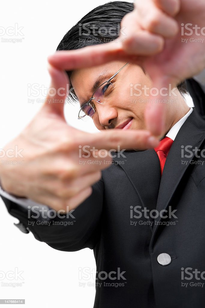 Asian businessman framing his perspective royalty-free stock photo