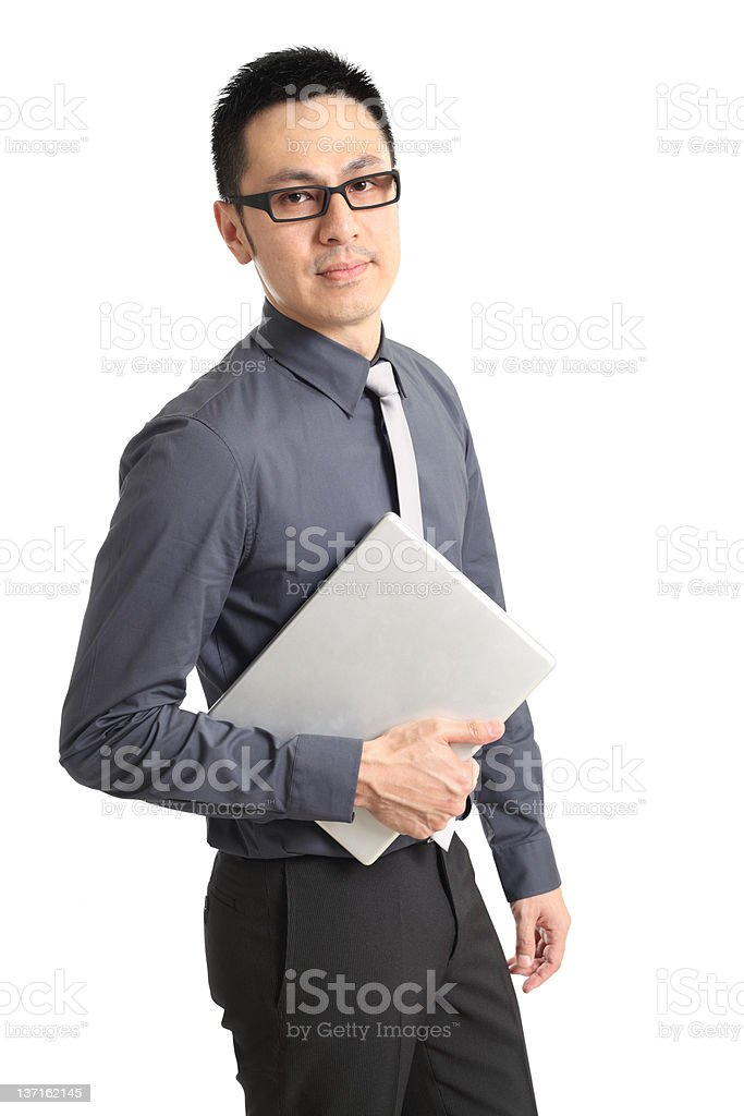 Asian businessman holding a laptop royalty-free stock photo