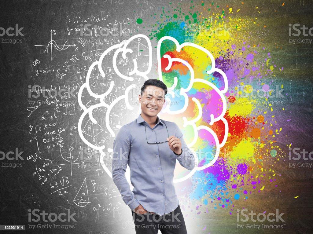 Asian businessman holding glasses, brain stock photo