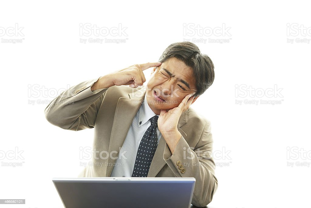 Asian businessman in an uneasy look royalty-free stock photo