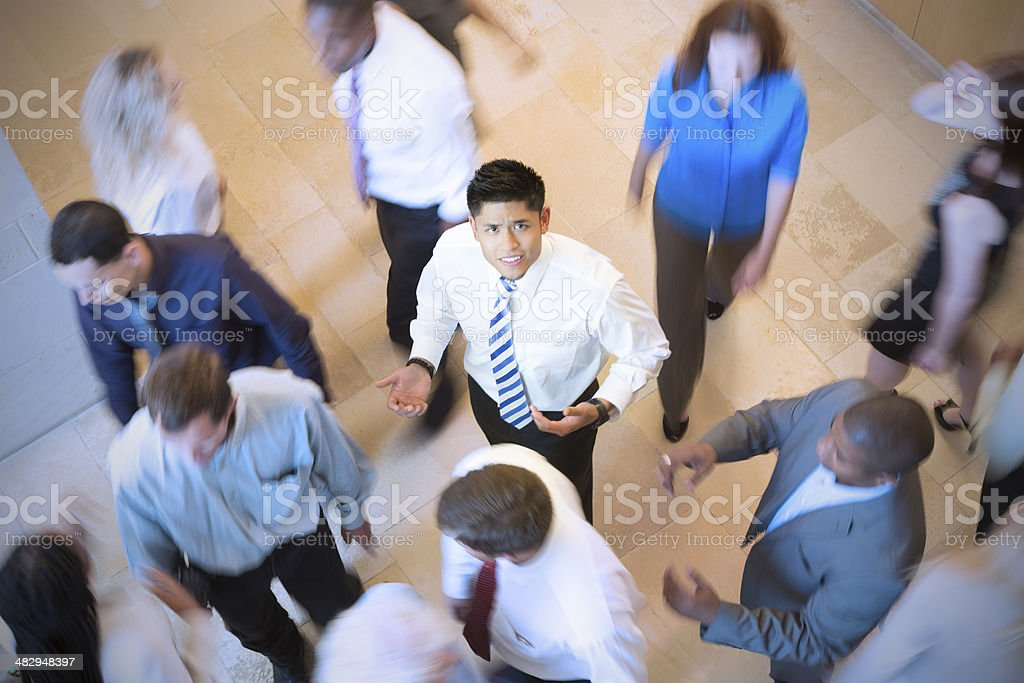 Asian businessman in busy crowd of executives royalty-free stock photo