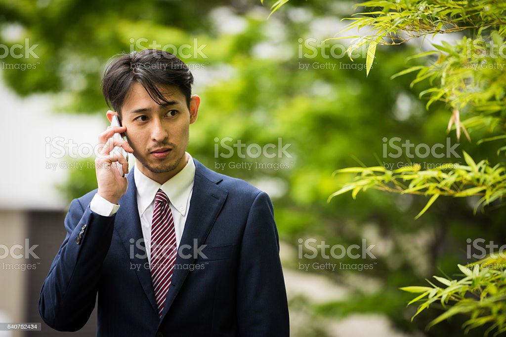 Asian businessman on the phone stock photo