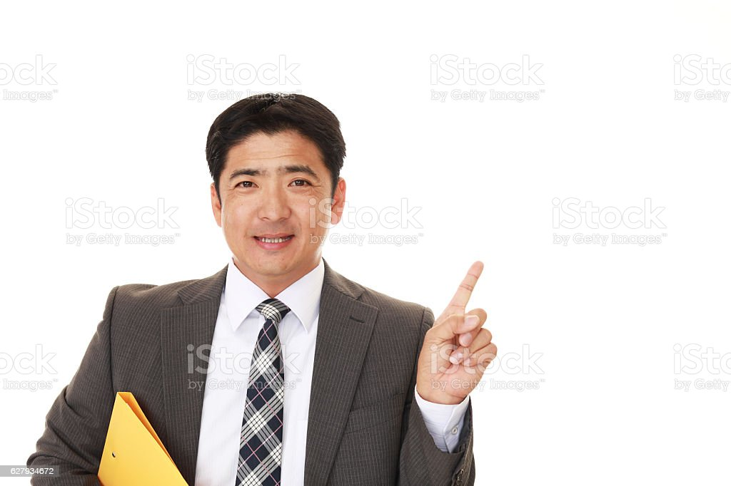 Asian businessman pointing stock photo