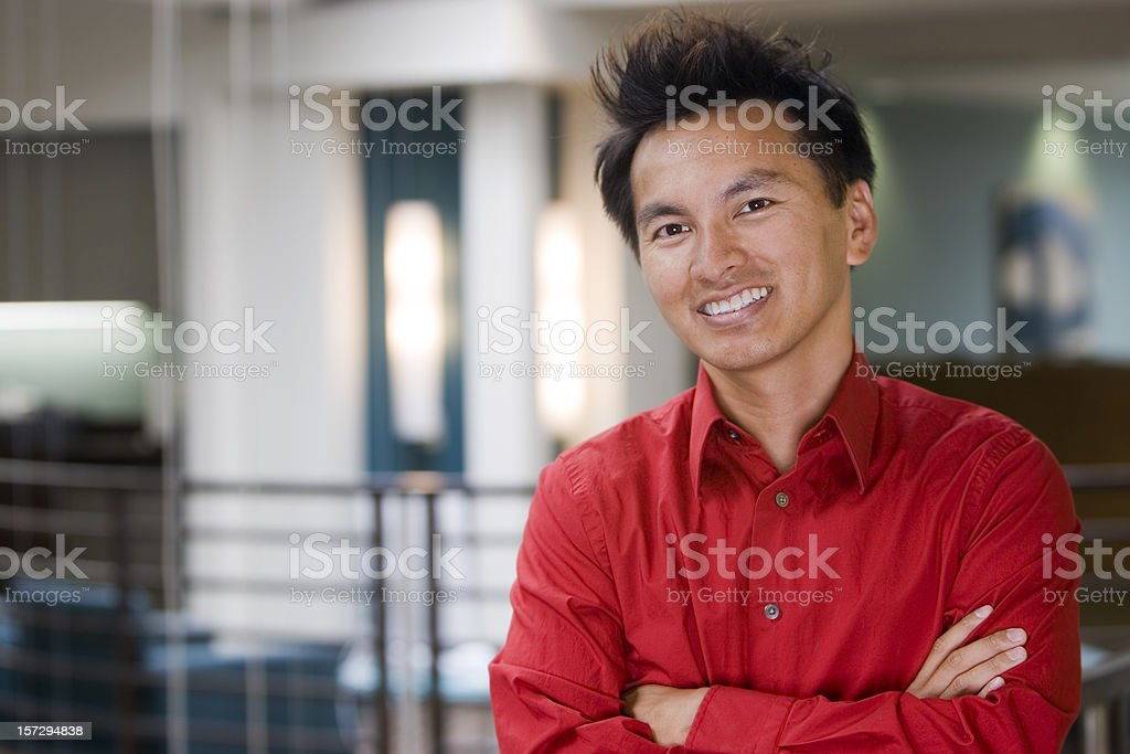 Asian Businessman Portrait with Arms Crossed in Office, Copy Space royalty-free stock photo