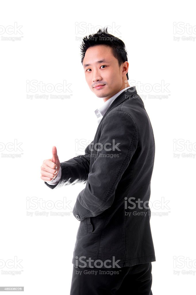 Asian Businessman Showing OK Sign With His Thumb Up royalty-free stock photo