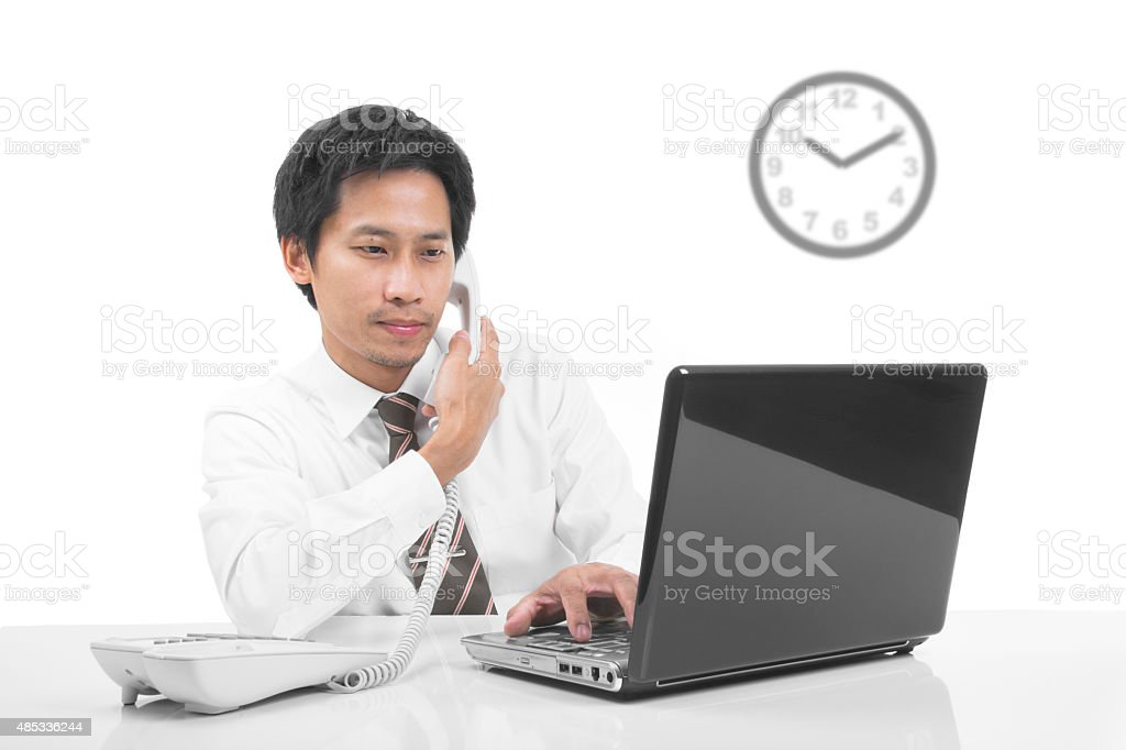 Asian businessman speaking on telephone royalty-free stock photo