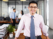 asian businessman standing in office