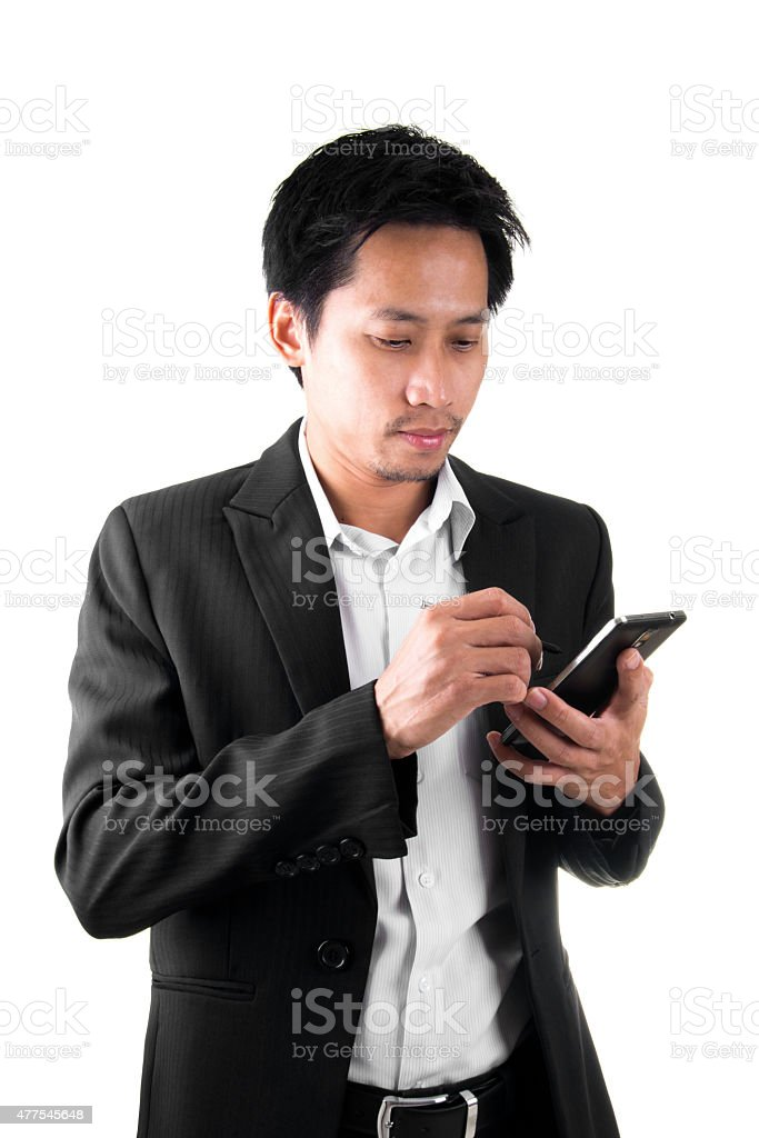 Asian Businessman Taking Notes On Mobile royalty-free stock photo