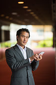 Asian businessman with a smart phone