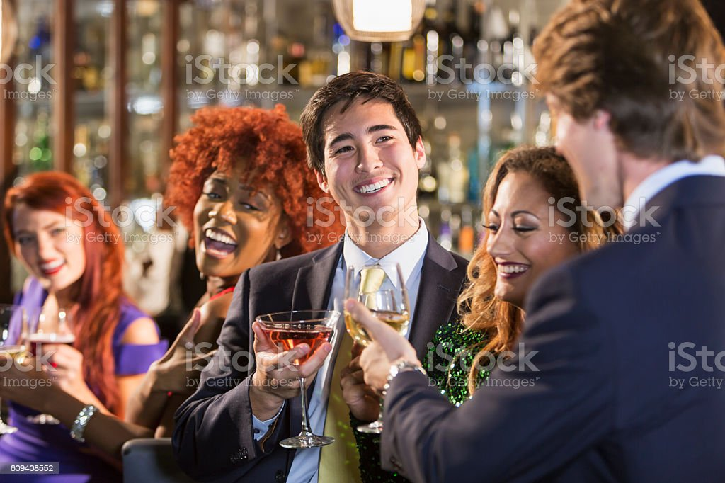 Asian businessman with friends at bar stock photo