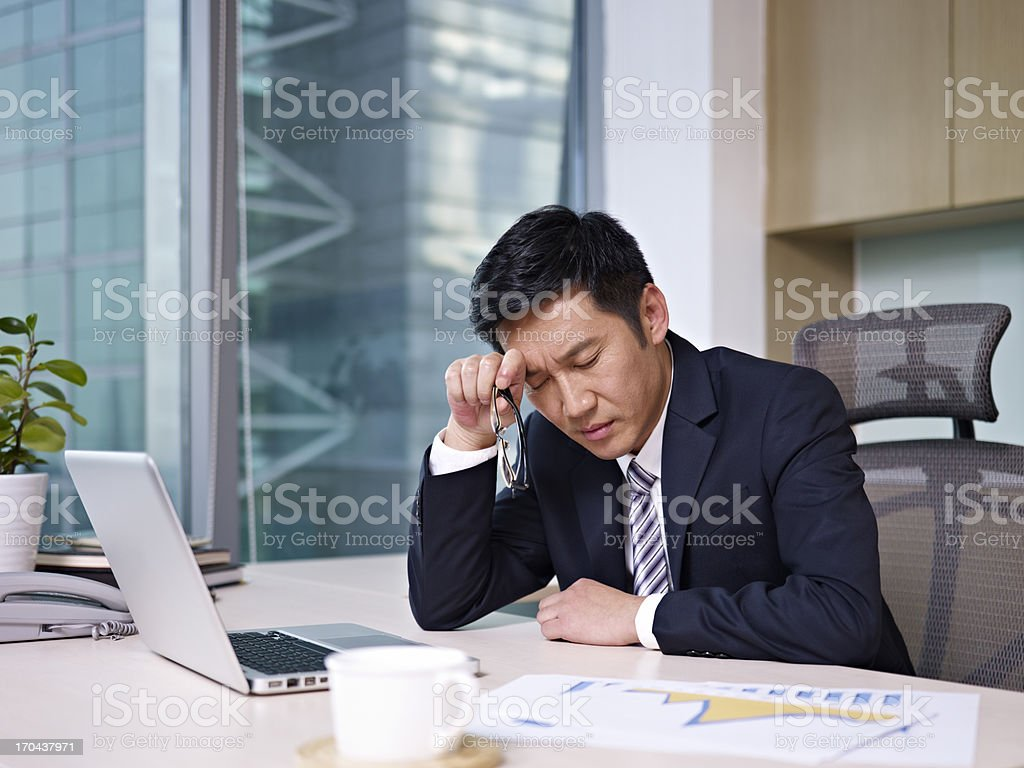 Asian businessman working on project stock photo