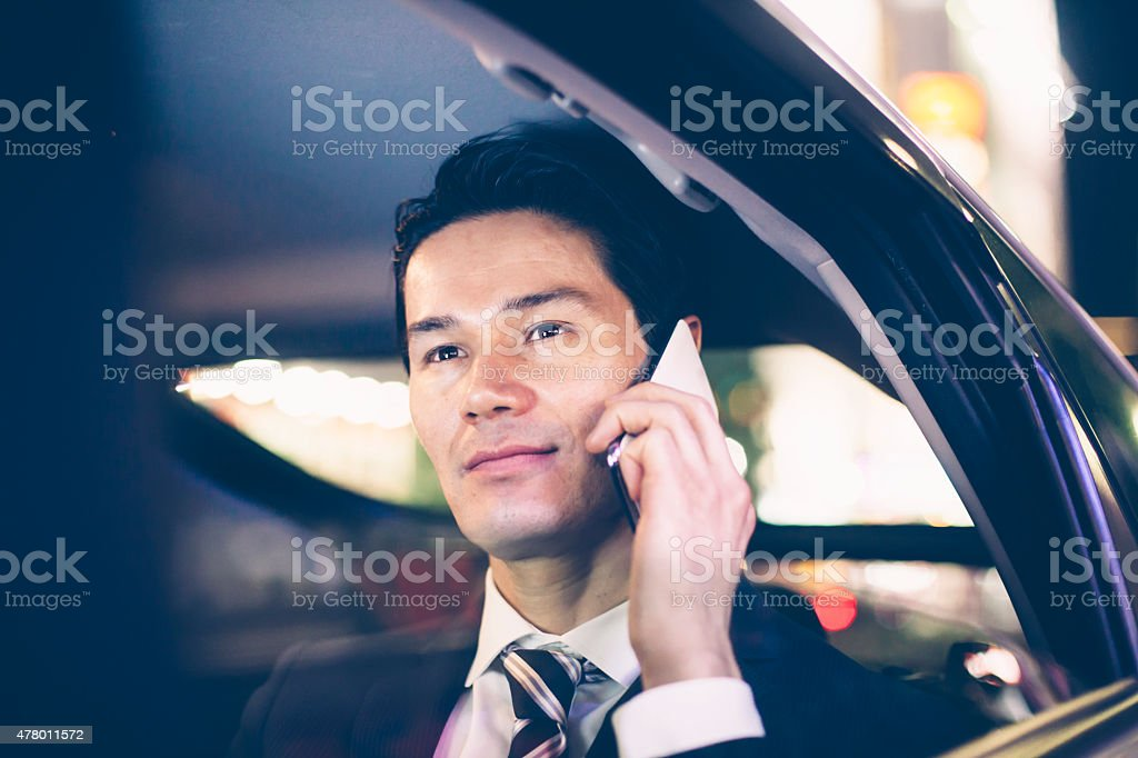 Asian businessmen at back seat of car stock photo