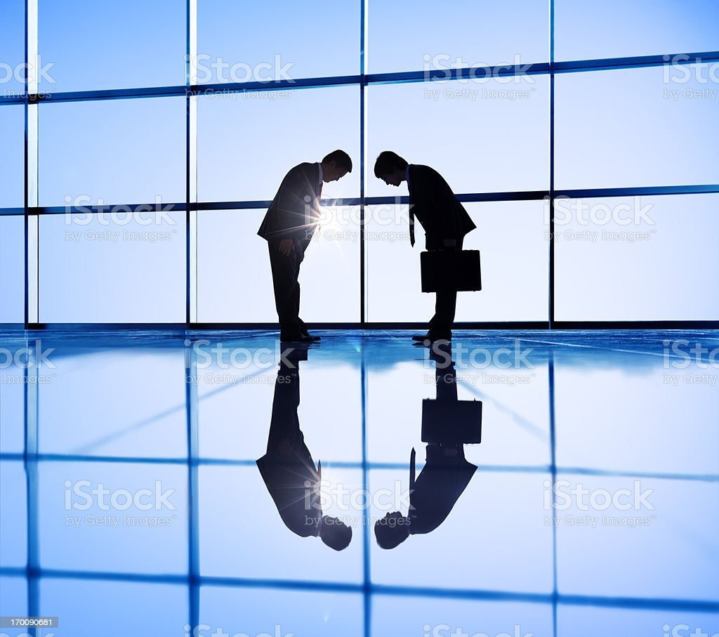 Asian Businessmen Bow. royalty-free stock photo