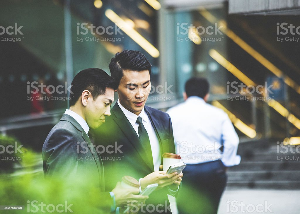 Asian businessmen on the phone. stock photo