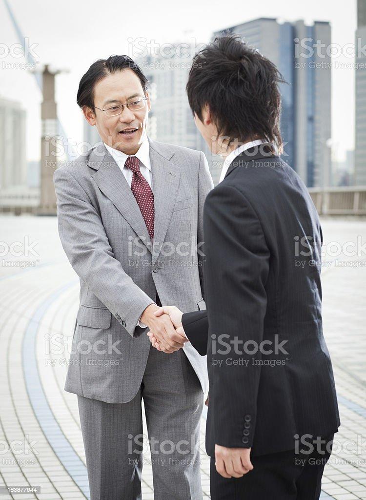 Asian Businessmen Shake Hands royalty-free stock photo