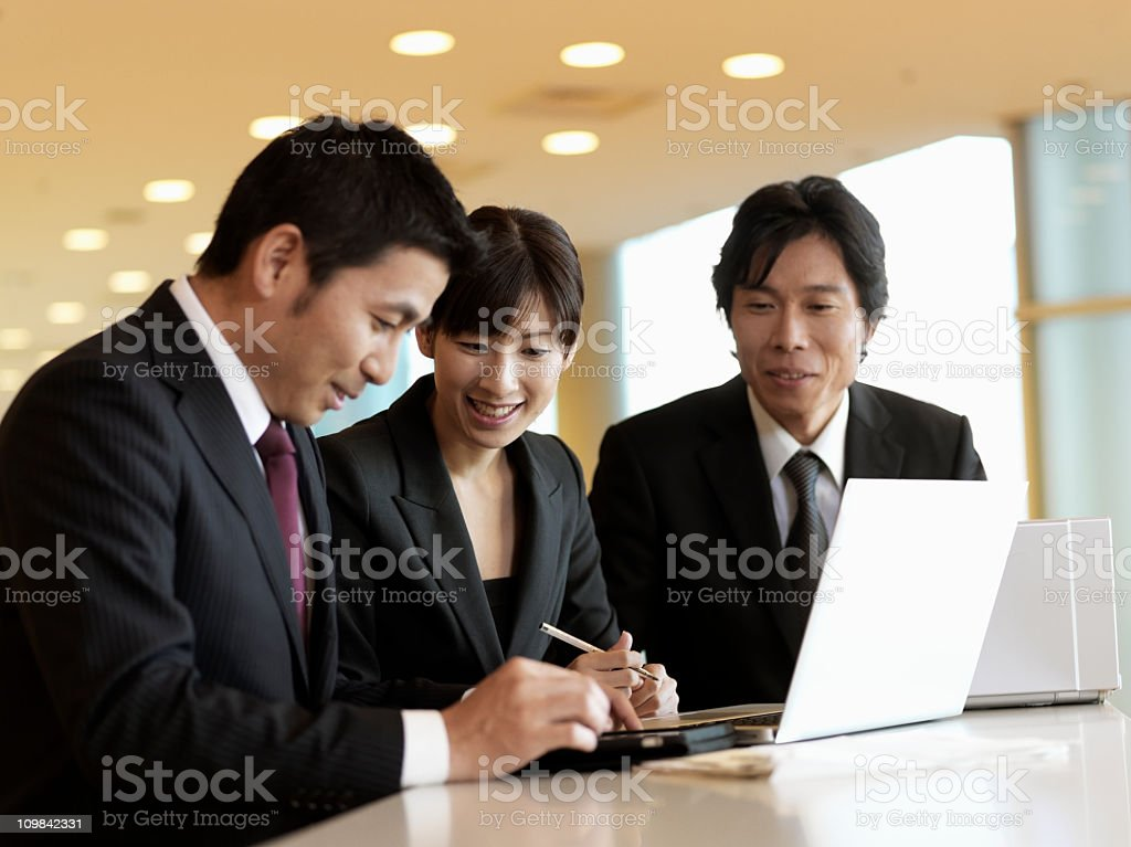 Asian Businesspeople Working Together at the Office royalty-free stock photo