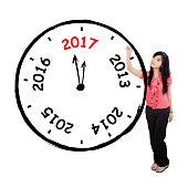 Asian businesswoman drawing a big clock