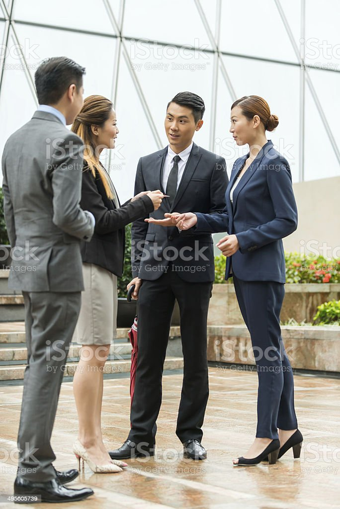 Asian Businesswoman Holding Business Card stock photo