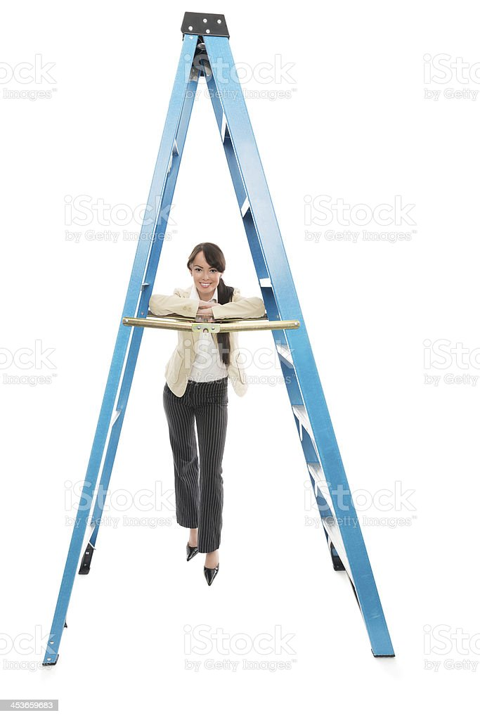 Asian Businesswoman Leaning On Ladder stock photo