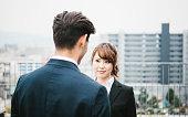 Asian Businesswoman Listening to Her Associate