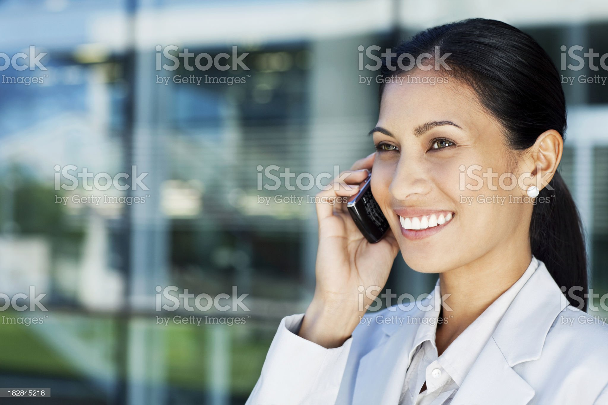 Asian Businesswoman on a Cellphone royalty-free stock photo
