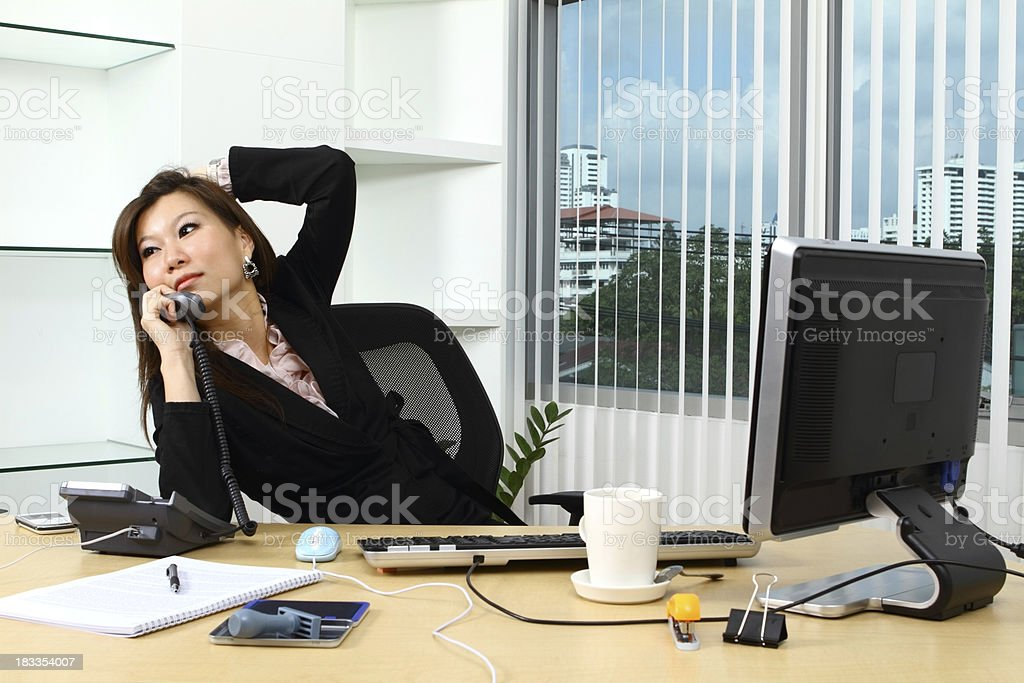Asian businesswoman on the phone stock photo