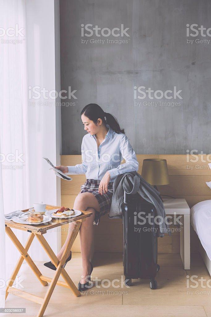 asian businesswoman reading newspaper stock photo