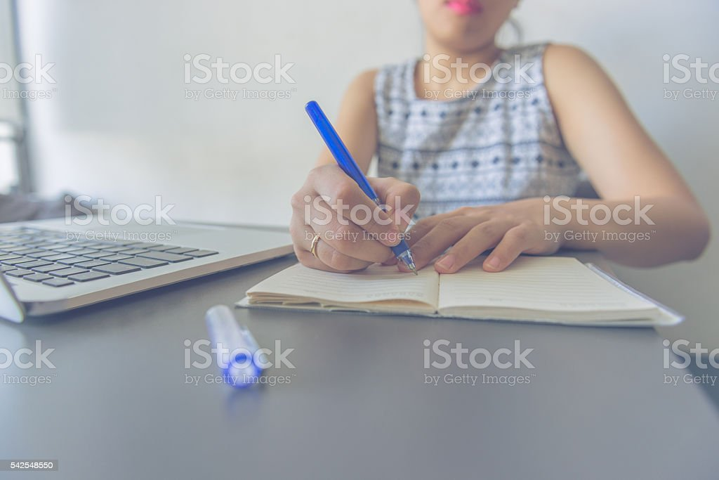 Asian businesswoman receive order of online customers and take note stock photo