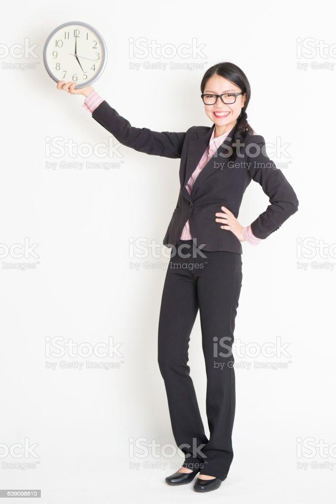Asian businesswoman showing clock 5pm stock photo