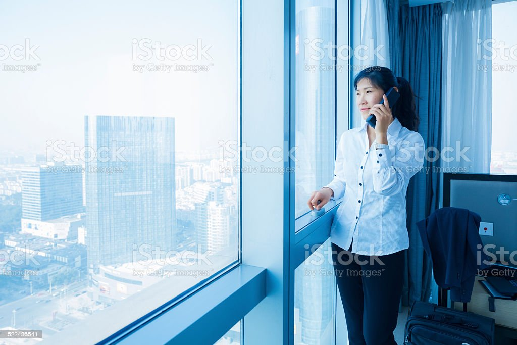asian businesswoman talking at hotel stock photo