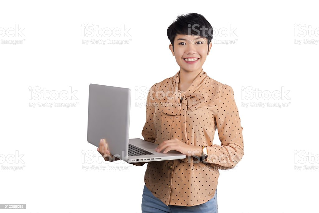 asian businesswoman using laptop on gray background. stock photo