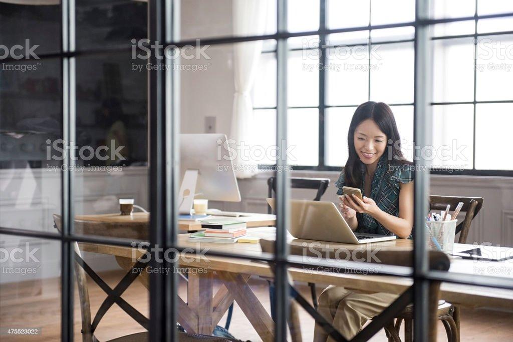 Asian businesswoman using smartphone stock photo