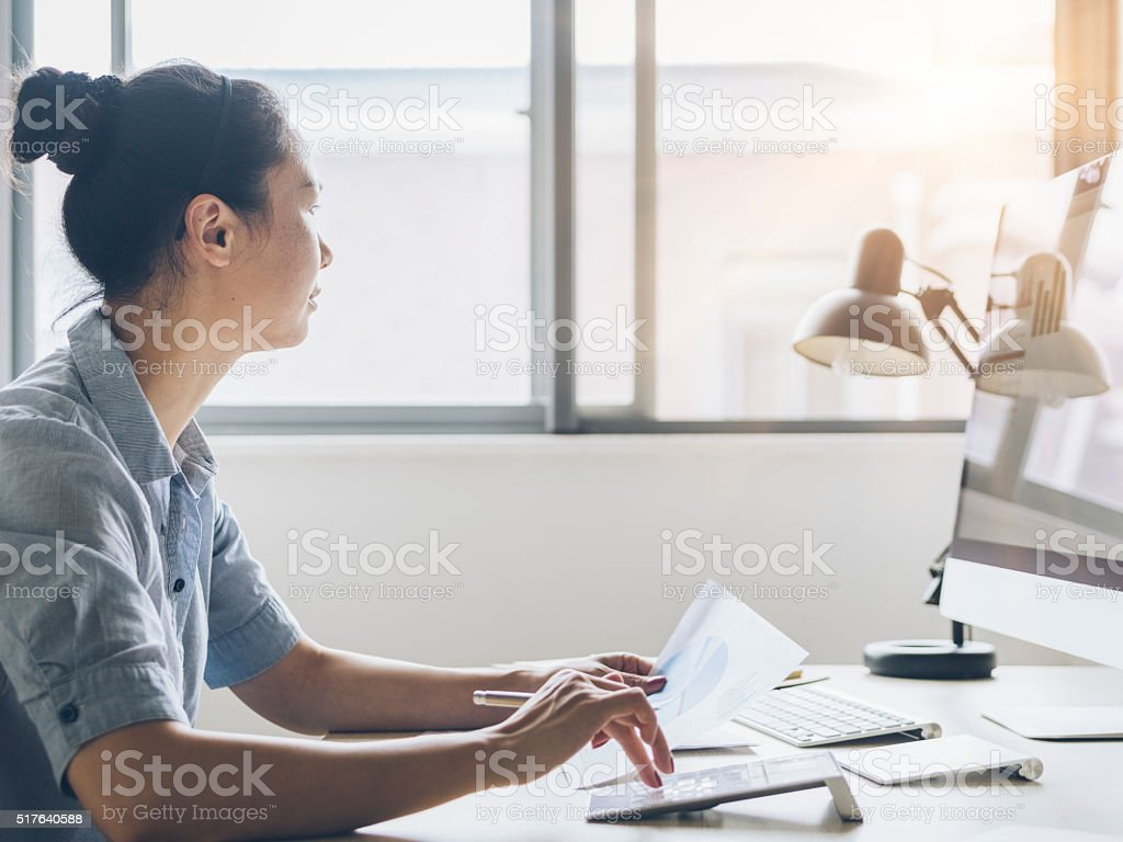 asian businesswoman working at home stock photo