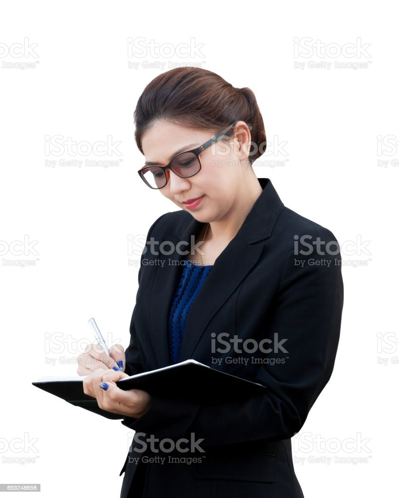 Asian businesswoman writing a note stock photo
